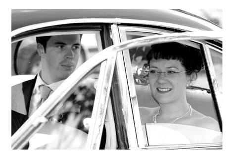 Bride and Groom in car at Sheffield Botanical Gardens