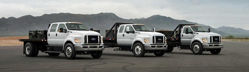 Line of White Ford Trucks