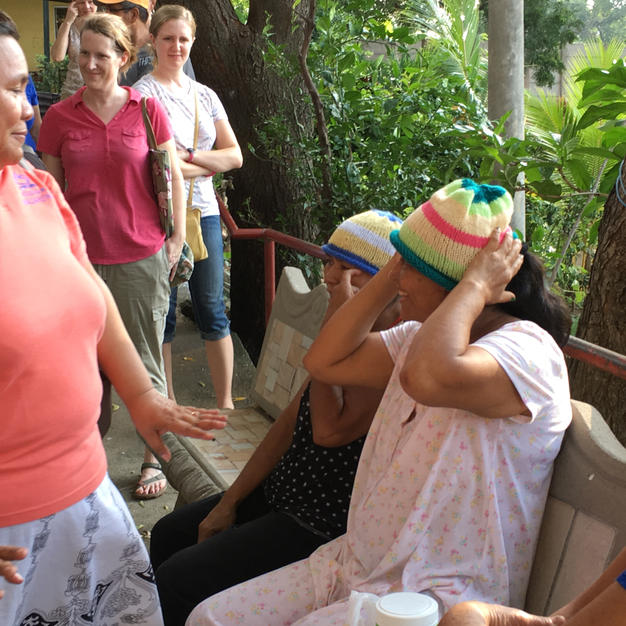 Giving Homemade Hats to Ladies in the Cancer Hospital