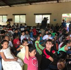 Children Excitedly Await a Program