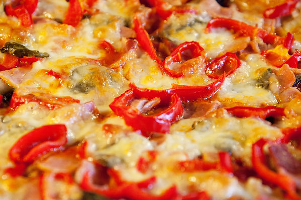 Close up of cheese and red pepper pizza