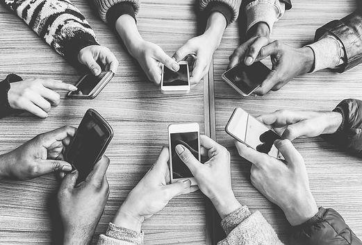 hands with phones.jpg