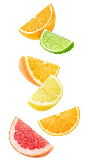 Isolated citrus fruits wedges. Falling p