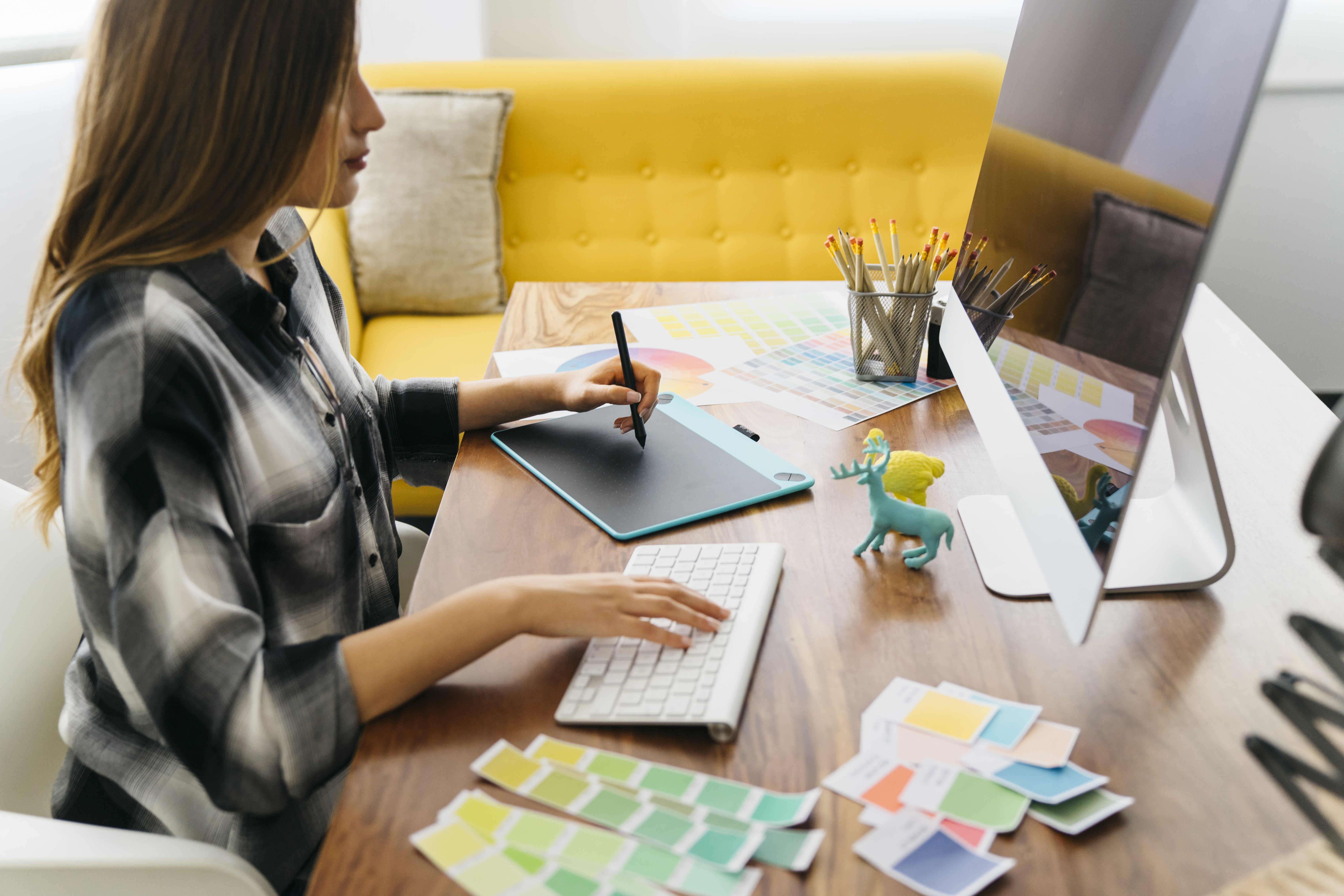side-view-of-graphic-designer-at-desk