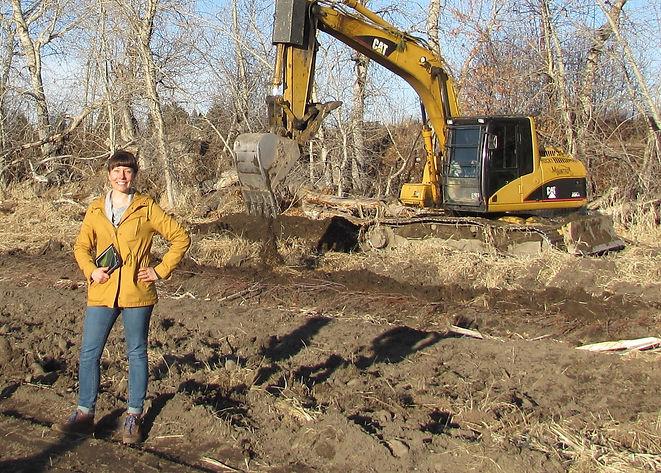 Heather with excavator.jpg