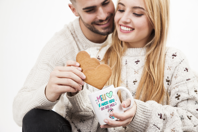 couple-dipping-cookies-into-mug.png
