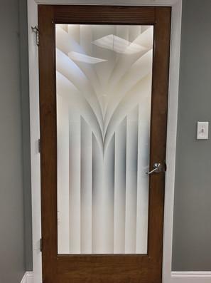Vetrilite custom etched glass film applied on office door glass