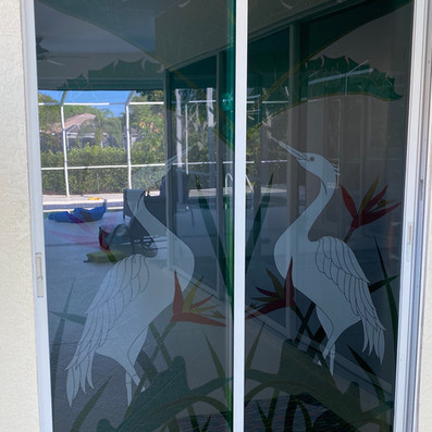 Vetrilite Custom Etched Glass Film applied on an exterior sliding door glass