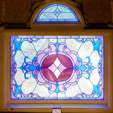 Vetrilite Custom Stained Glass Film applied on an exterior window.