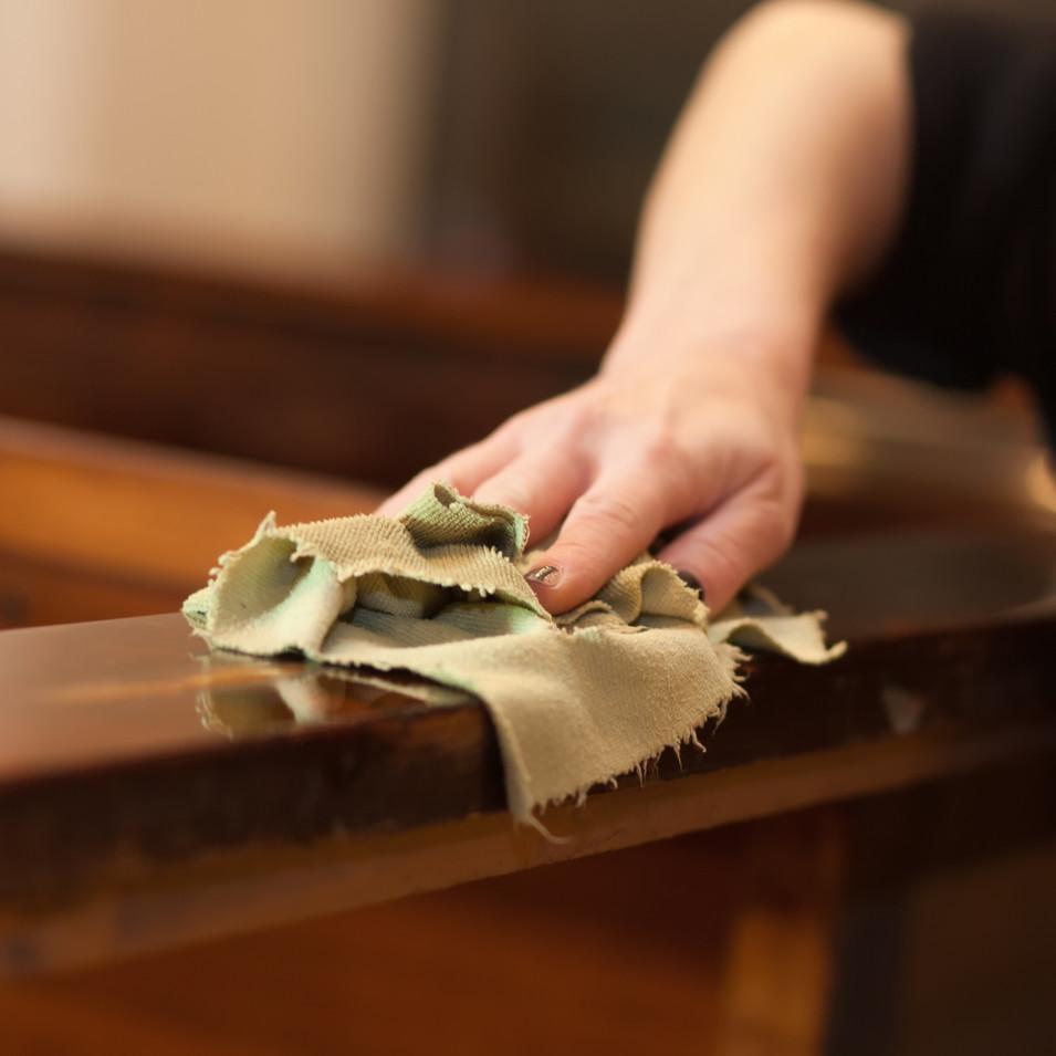 woman restoring furniture