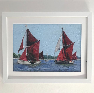 Thames barge sailboats.