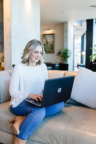Jowhitewellbeing-oncouchwithlaptop.jpg