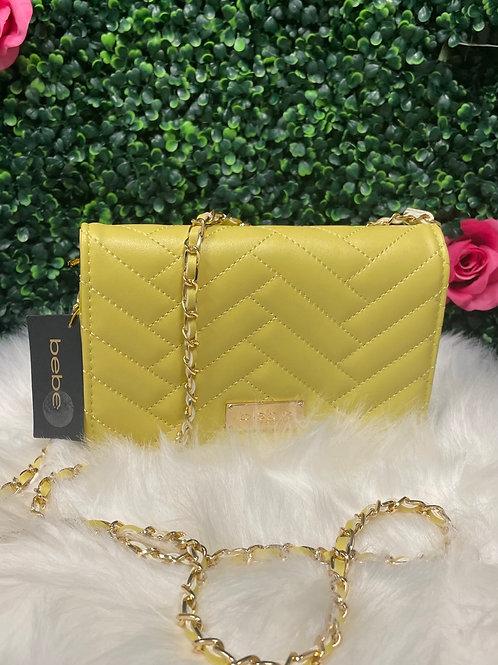 Bebe yellow clutch purse