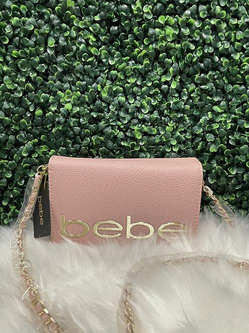 BEBE pink clutch purse