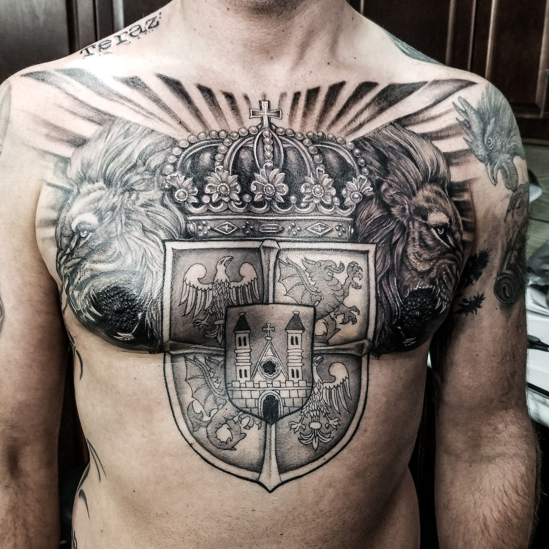family crest and lions tattoo.jpg