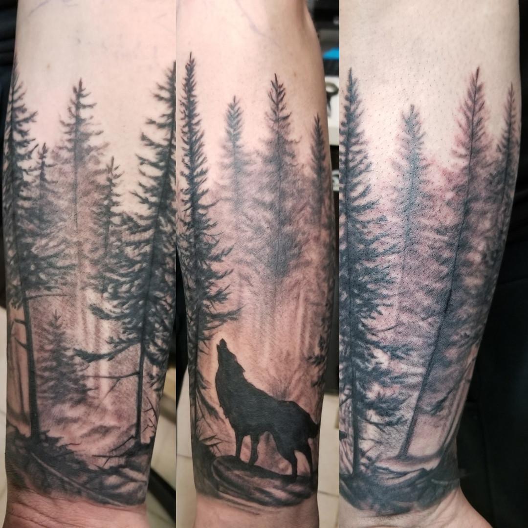 wolf trees tattoo.jpg
