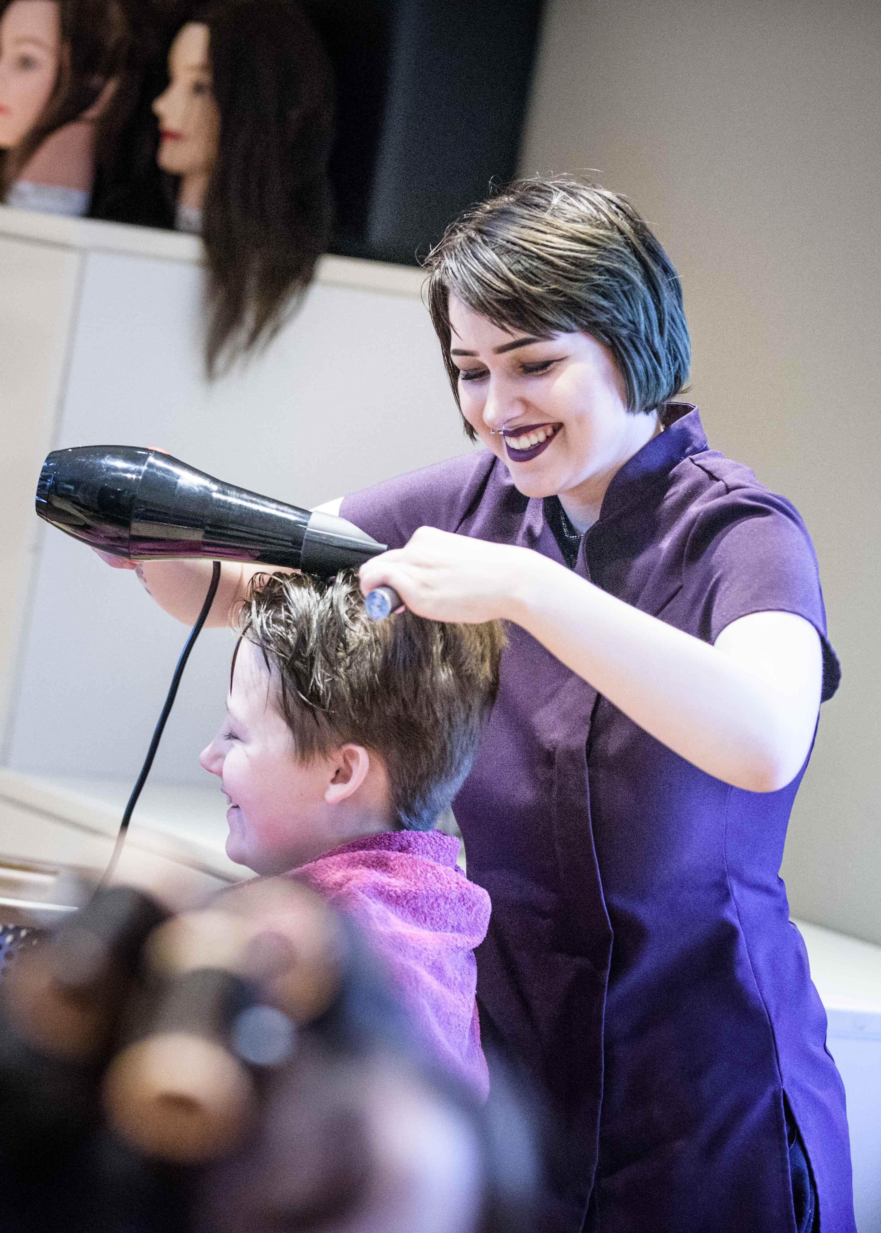 Hairdressing student with client