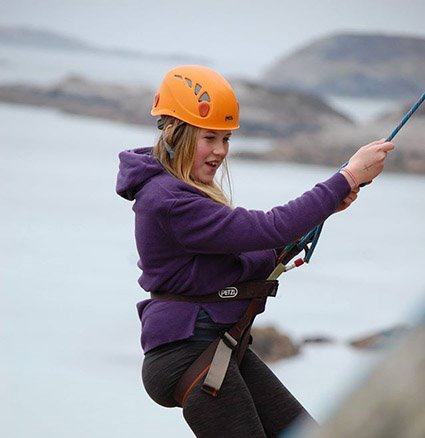Young woman abseiling