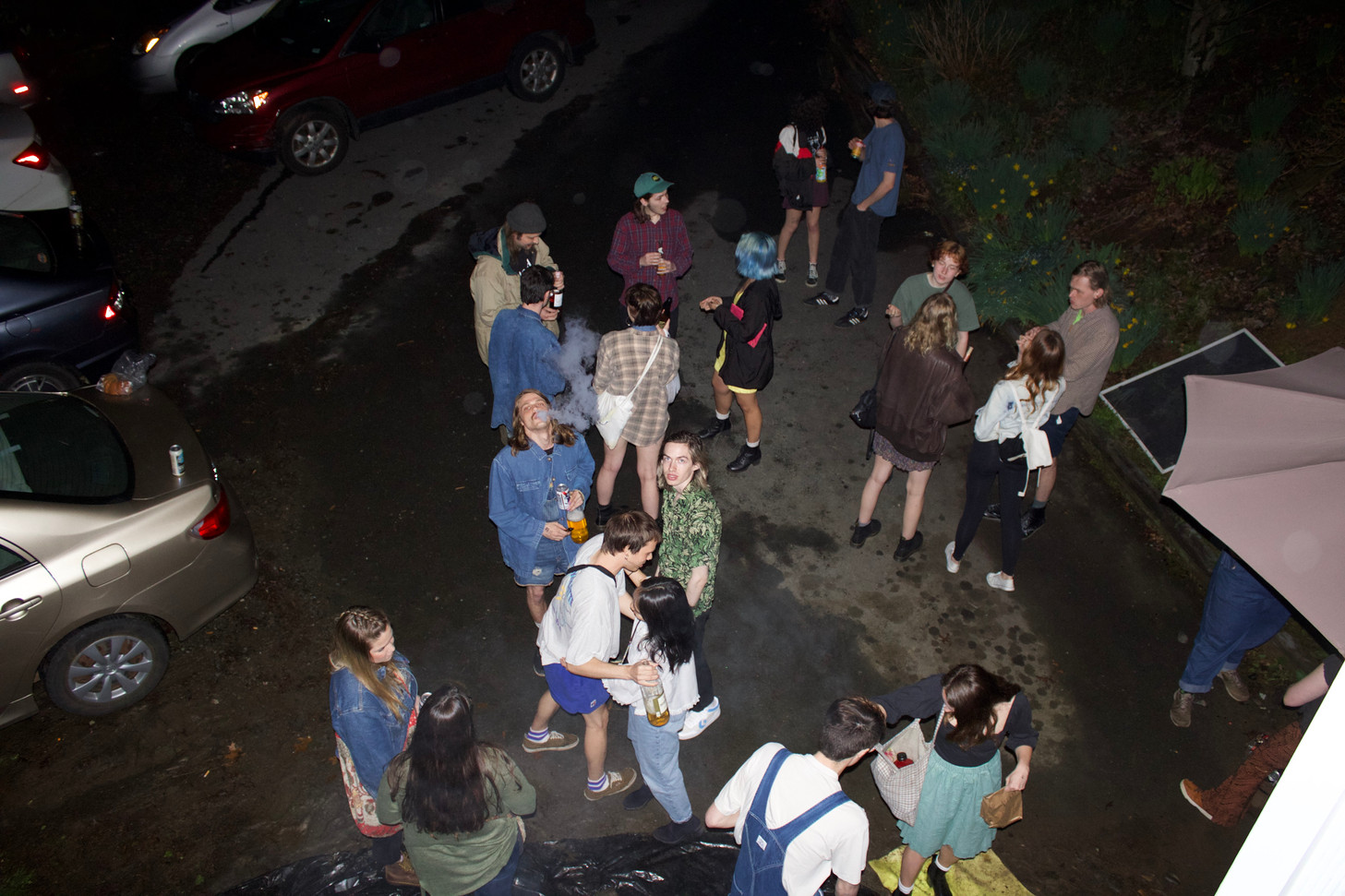 Audience members gather outside of The Womb and greet each other before going in to enjoy some music.