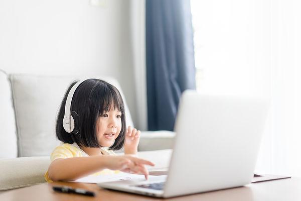 Asian girl student wear wireless headpho