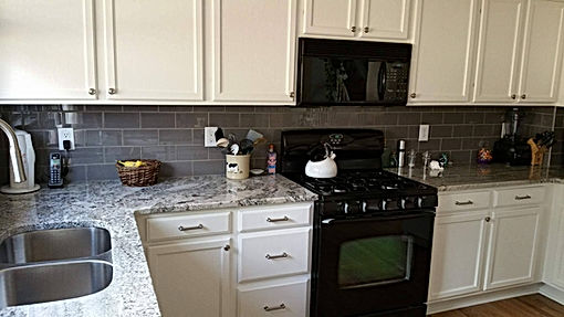 Home improvement contractor kitchen remodel in Littleton with glass backsplash