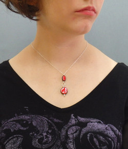 Collier perles rouges : 37€