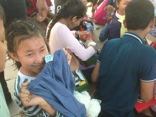 2016 Cambodia- girl opens clothing.jpg