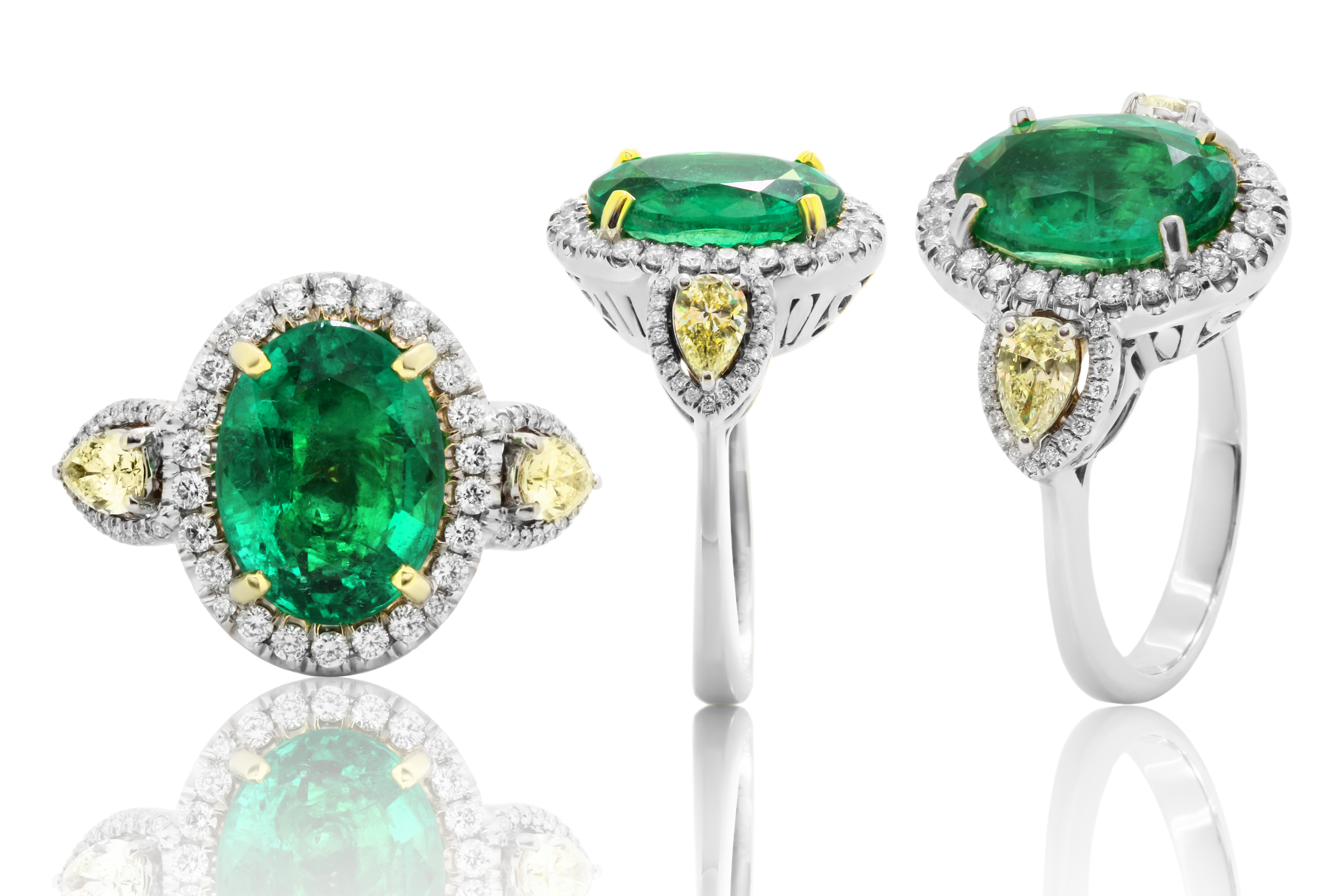 Emerald ring with diamonds and gems_