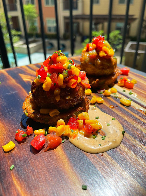 Jumbo Lump Crab Cakes over Fried Green Tomatoes on Remoulade Sauce topped w/ Corn Tomato Relish w/ Pepper Jam Drizzle