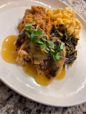 Cajun Roasted Chicken w/ Herb Gravy, Maple Brown Sugar Sweet Potato Mash, Truffle Mac n Cheese & Braised Collard Greens