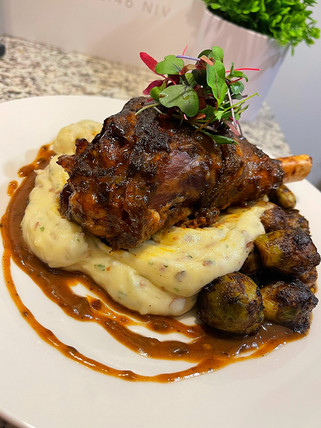 Port Wine Braised Lamb Shank w/ Rosemary Mint Demi Glace over Black Truffle Mash & Balsamic Roasted Brussel Sprouts
