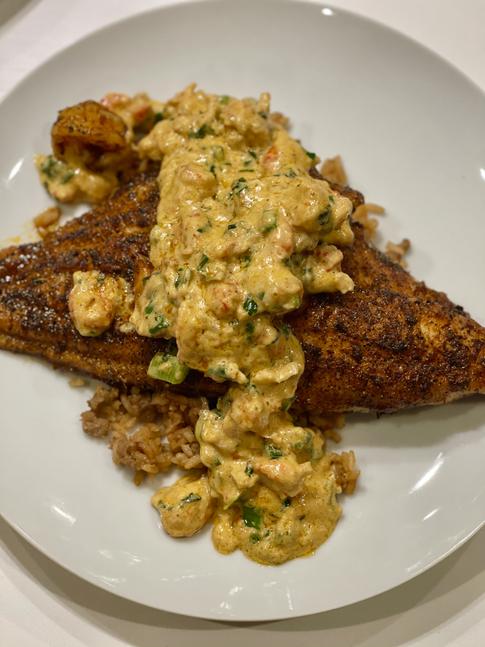 Blackened Catfish Ponchatrain w/ Creamy Crawfish Sauce over Dirty Rice