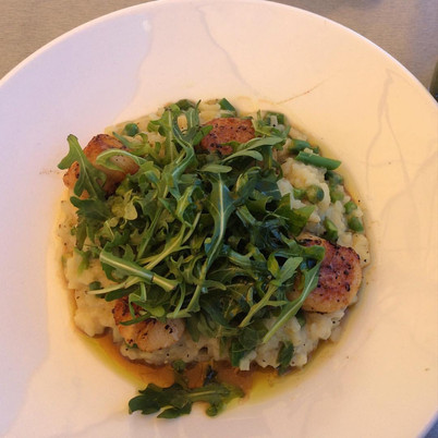 Seared Scallops over Lemon Parmesan Asparagus Risotto topped w/ Argula