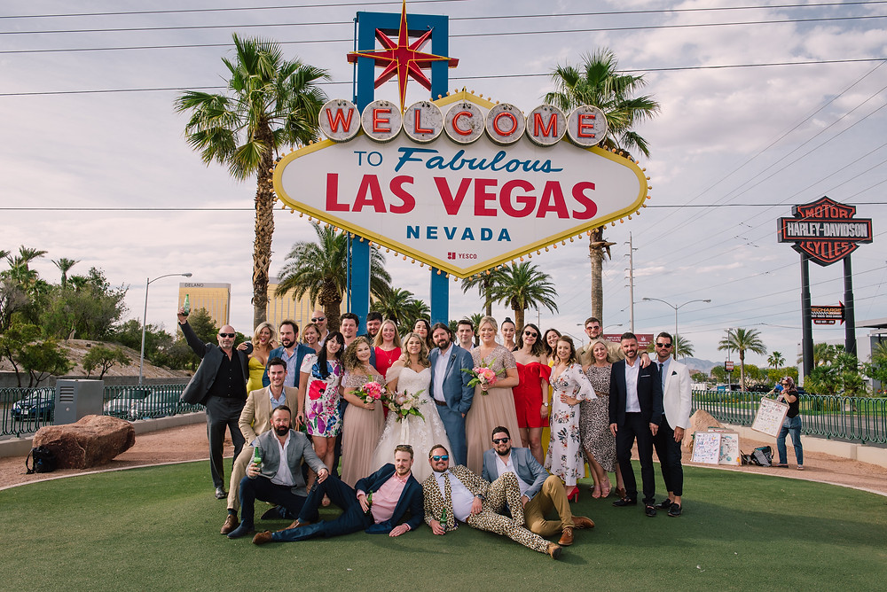 Wedding guests gather at the famous Las Vegas Sign for an epic photo