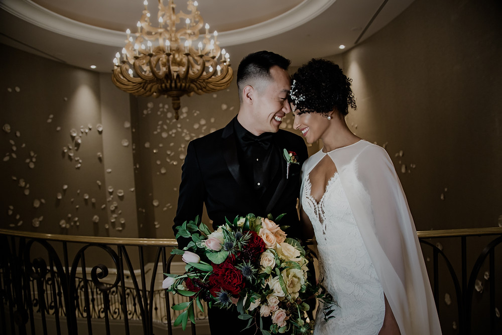 Husband and Wife grab a moment alone and share a smile at their wedding