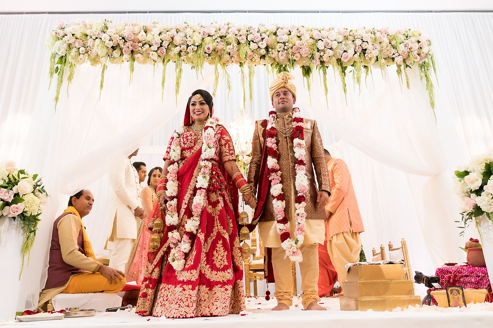 Bride and Groom stand under the mandap