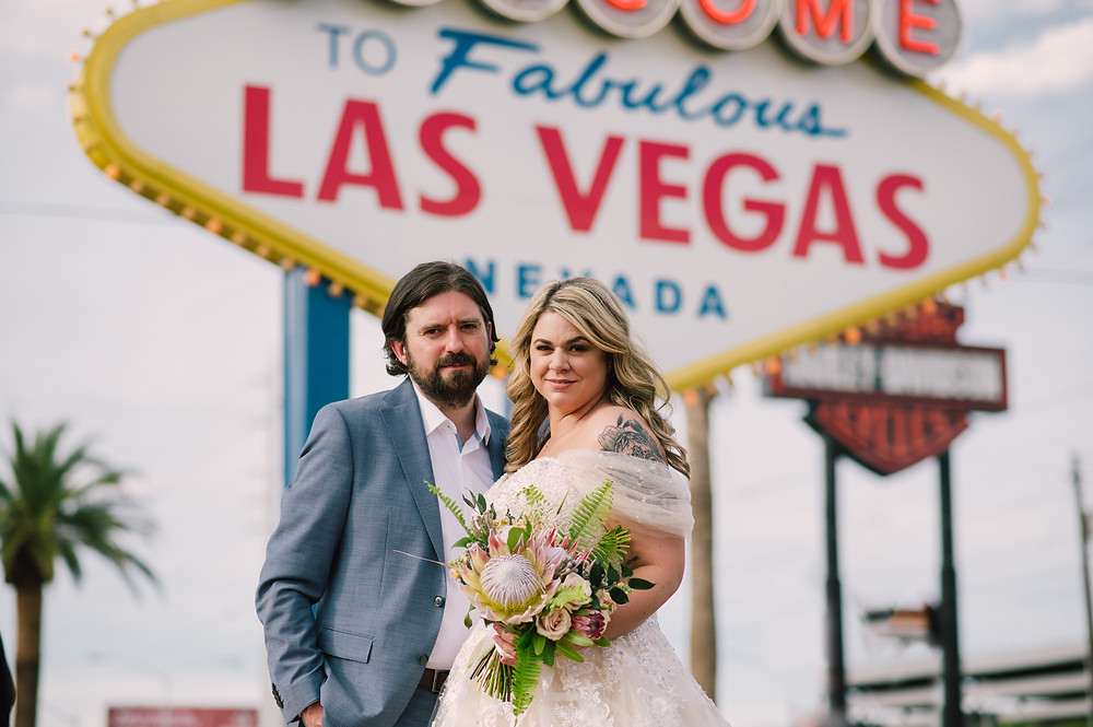 Bride and Groom in front of the Las Vegas sign