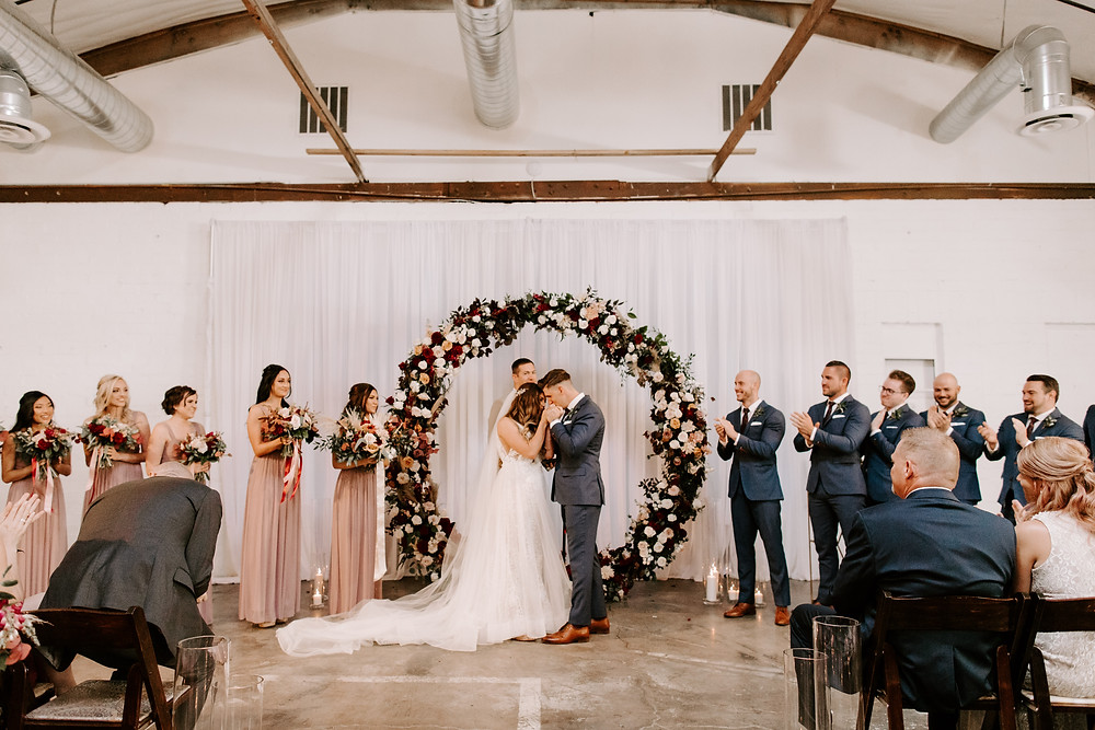 Bride and Groom infant of circle arch ceremony