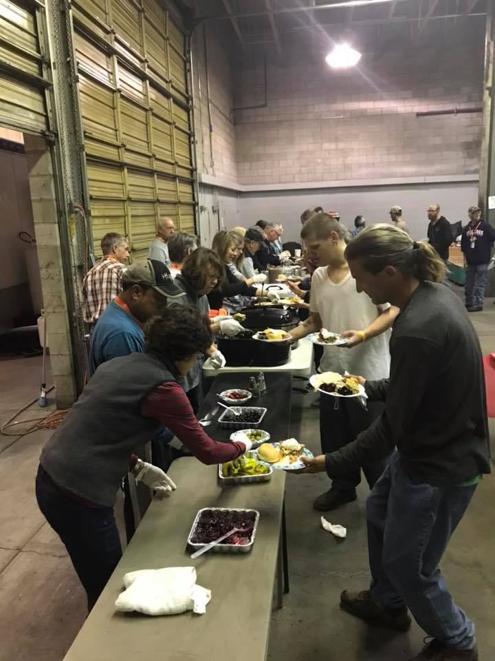 volunteers serve dinner nightly