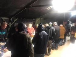 Volunteers serving dinner