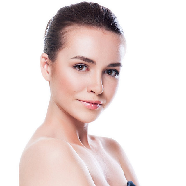Beautiful face of young adult woman with
