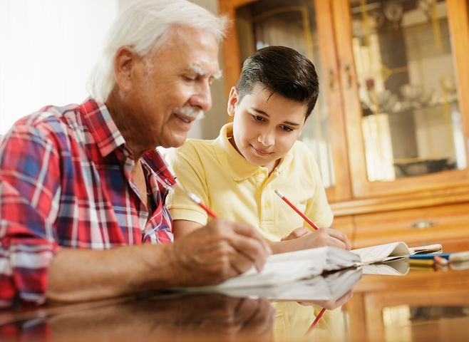 Grandfather and foster child. Doing Homework. Ontario Foster care.