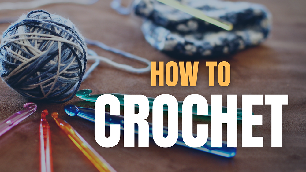 """""""How to Crochet"""" sits on top of a ball of yarn and colorful crochet hooks"""
