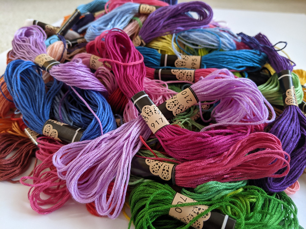 A pile of colorful embroidery floss.