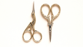 Why are embroidery scissors shaped like storks?