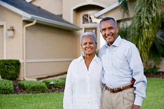 elderly couple in front of home.jpg