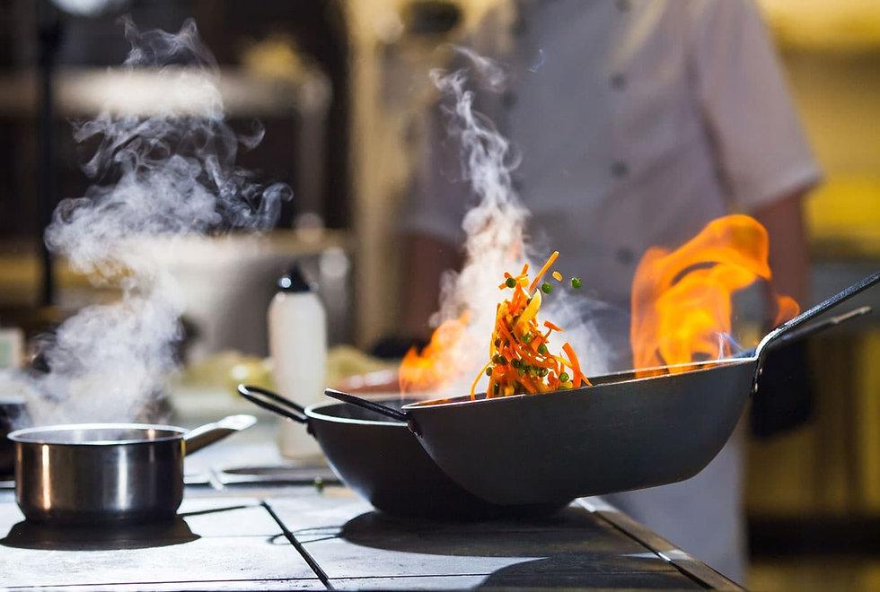 cook-making-dinner-kitchen-high-end-rest