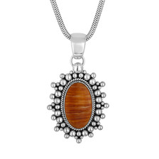Spiny Oyster oval pendant by Navajo artist Artie Yellowhorse