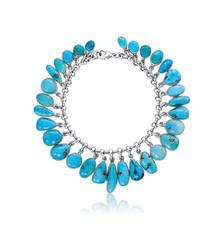 Turquoise charm bracelet set in Sterling Silver