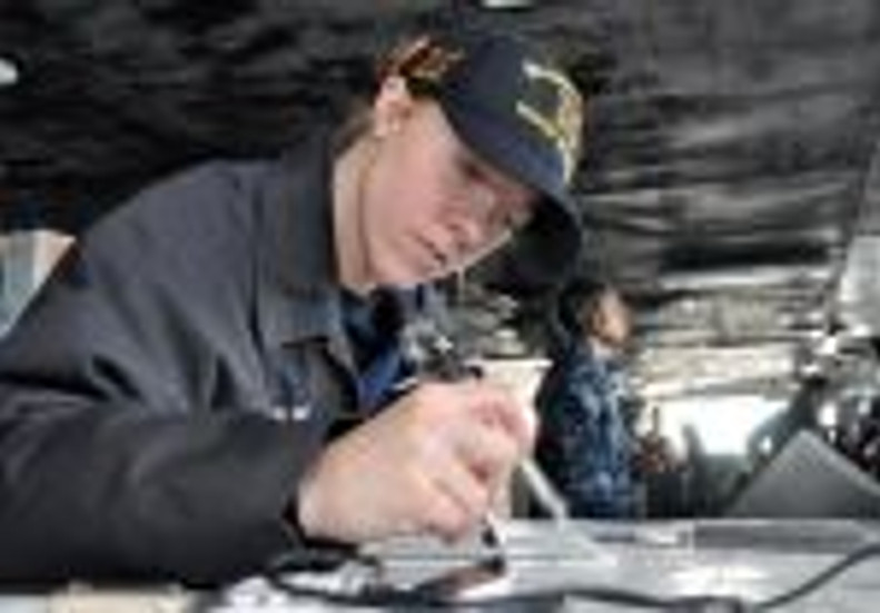 Jaime Plym - navigator plotting course for USS R Reagan